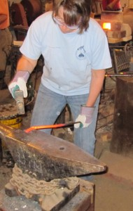 Me blacksmithing at Old West Forge